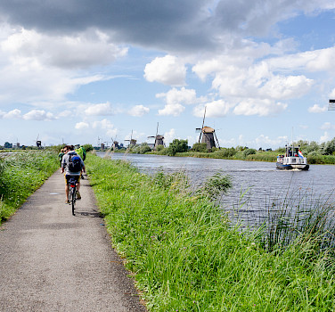 Bike and boating the Kinderdijk, South Holland, the Netherlands. Photo via Flickr:Luca Casartelli