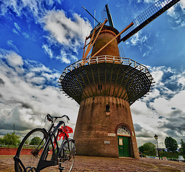 Bike rest at windmill in Rotterdam, South Holland, the Netherlands. Photo via Flickr:Luca Bolatti Guzzo