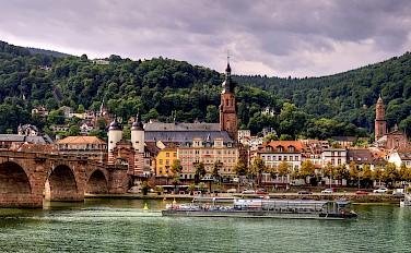 Old Bridge over the Neckar River in Heidelberg, Germany. Photo via Flickr:Alex Hanoko