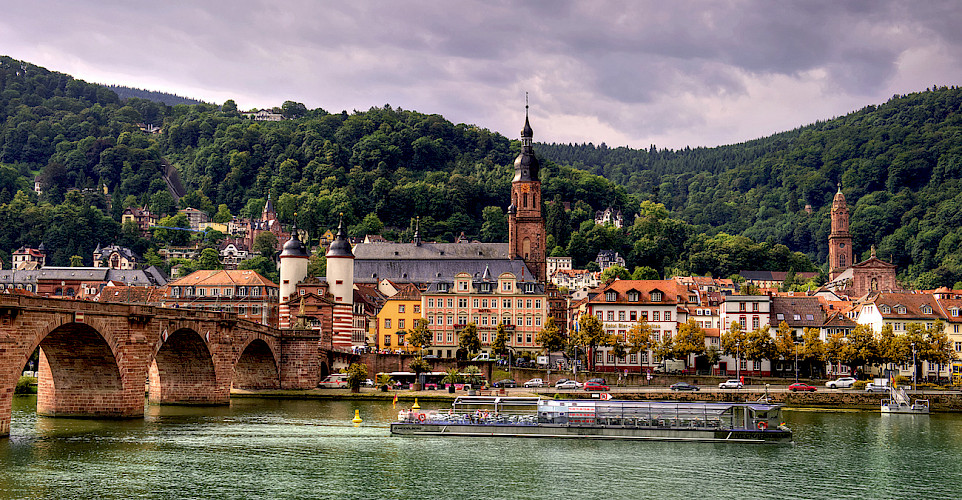 Old Bridge over the Neckar River in Heidelberg, Germany. Photo via Flickr:Alex Hanoko