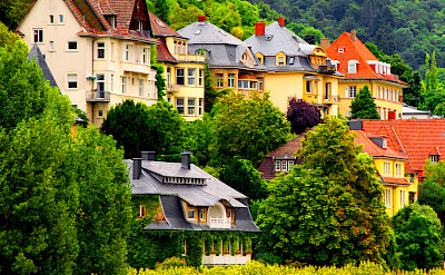 Colorful homes along the Neckar River in Heidelberg, Germany. Photo via Flickr:Tobias van der Haar