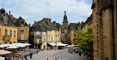 Shopping in a Bastide town in Dordogne, France. Photo via Flickr:Lynn Rainard