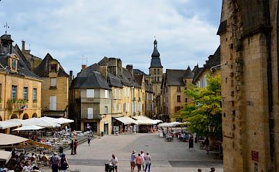 Shopping in a Bastide town in Dordogne, France. Photo via Flickr:Lynn Rainard