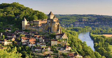 Biking through Beynac in Dordogne, France. Photo via Flickr:Francisco Javier Garcia Orts
