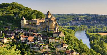 Biking through Beynac in Dordogne, France. Photo via Flickr:Francisco Javier Garcia Orts