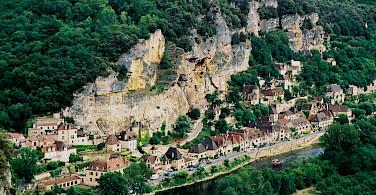 La Roque Gageac along the Dordogne River, France. Photo via Flickr:LaurPhil