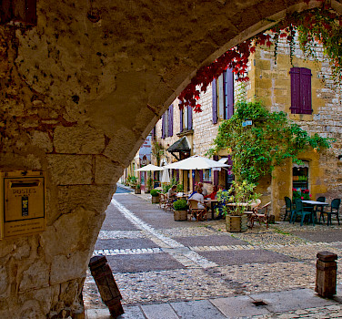Biking through Monpazier, Dordogne, France. Photo via Flickr:Phillip Capper