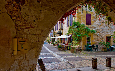 Biking through Monpazier, Dordogne, France. Photo via Flickr:Phillip Capper