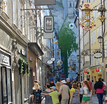 Shopping on famous Getreidegasse in Old Town Salzburg, Austria. Photo via Flickr:flightlog
