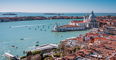 Tower view from San Marco Square in Venice, Italy. Photo via Flickr:Sergey Galyonkin