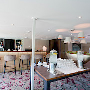 Fully stocked, bright, and welcoming bar area on board - MS Arkona