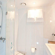 All the comforts of home in private bathrooms on board the Arkona | Bike & Boat Tours