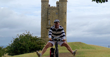 Biking glee at the Broadway Tower, England.