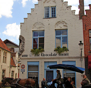 Chocolate Shop in Bruges, Belgium. Photo via Flickr:raider of gin