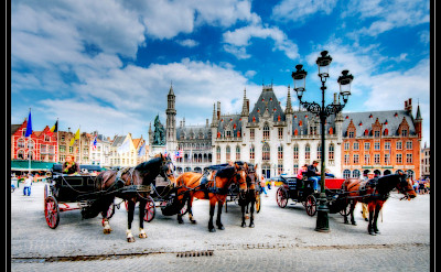 Horse-drawn carriages in Bruges, Belgium. Flickr:Wolfgang Staudt