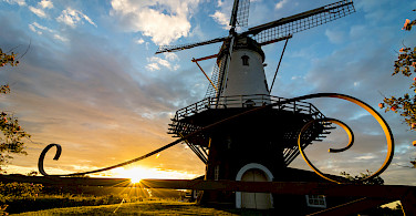 Windmill at sunset in Veere in Zeeland, the Netherlands. Photo via Flickr:dynphoto