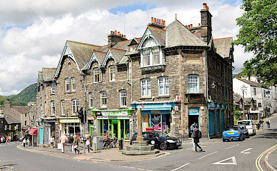 Shopping in Ambleside, Cumbria in the Lakes District, England. Photo via Wikmedia Commons:Nilfanion