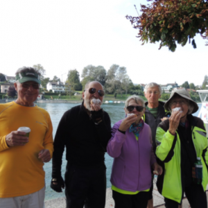 Posing for a group shot with our snacks by the Rhine River