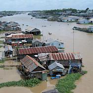 Along the river in Chau Doc, Vietnam. Photo via Flickr:Ken Marshall