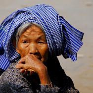 Old woman wearing the traditional <i>krama</i> headdress in Kampong Thom, Vietnam. Photo via Flickr:BMR & MAM
