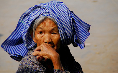 Old woman wearing the traditional <i>krama</i> headdress in Kampong Thom, Vietnam. Photo via Flickr:BMR & MAM