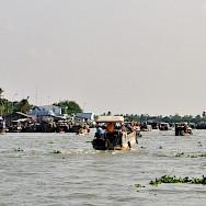 Boat ride on the Mekong River in Vietnam. Photo via Flickr:Jean-Marcastesana