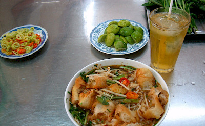 Breakfast in Saigon, now known as Ho Chi Minh City, Vietnam.Photo via Flickr:Prince Roy