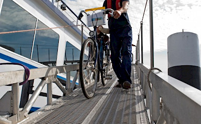Bikes being unloaded from De Nassau | Bike & Boat Tours