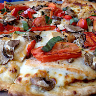 Delicious pizza in Tuscany, Italy. Photo via Flickr:Ray Bouknight