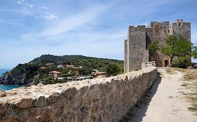 Biking through Talamone, Tuscany, Italy. Photo via Flickr:Allie Caulfield