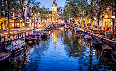Amsterdam lit up at night in North Holland, the Netherlands. Flickr:Sergey Galyonkin