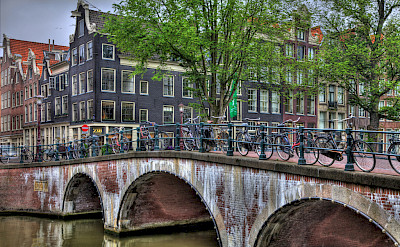 Canals and the famous facades of Amsterdam, North Holland, the Netherlands. Flickr:vgm8383