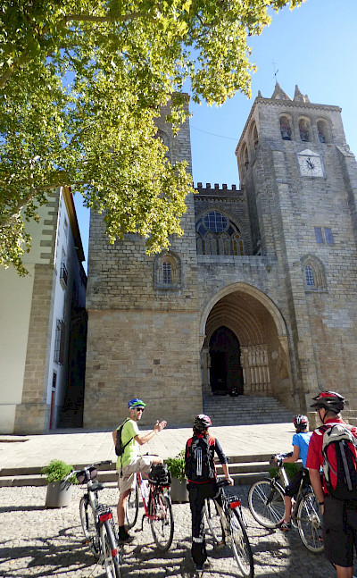 Bike rest to admire Sé de Évora in Alentejo, Portugal.
