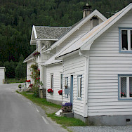 White houses mark the landscape here in Norway. Photo via TO.