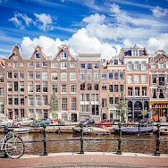 Bikes and canals in Amsterdam, North Holland, the Netherlands. Photo via Flickr:Andresnietoporras