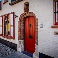 Beautiful facades in Bruges, Belgium. Photo via Flickr:Ron Kroetz
