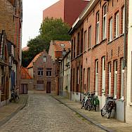 Cobblestone streets in Bruges, West Flanders, Belgium. Photo via Flickr:Elroy Serrao