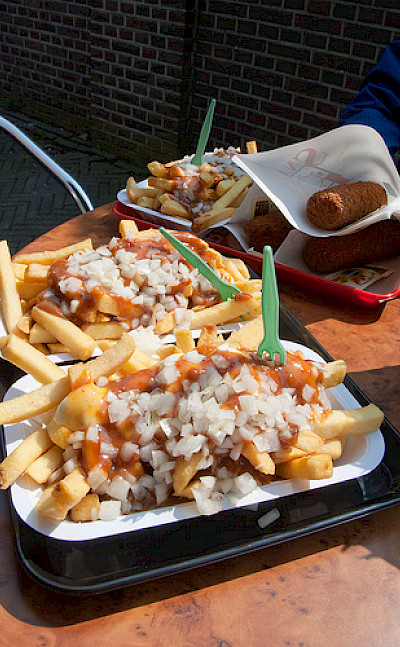 """Dutch fries with curry ketchup, onions and """"kroketten."""" Photo via Flickr:vitamindave"""