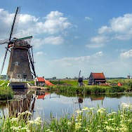 Really scenic cycling through Kinderdijk in South Holland, the Netherlands. Flickr:John Morgan