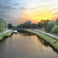 Leie River in Ghent at sunset, Belgium. Wikimedia Commons:Graham Richter