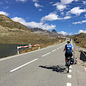Biking the Bernina Pass through the mountains in Switzerland. Photo via TO