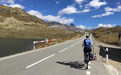 Biking the Bernina Pass through the mountains in Switzerland. Photo via TO