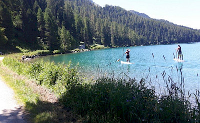Paddle boarding on one of the lakes en route. Photo via TO