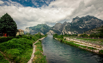 Cycling along the path in Riva del Garda, Italy. Flickr:waldemarmerger