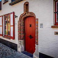 Cobblestone streets and painted shutters in Bruges, Belgium. Flickr:Ron Kroetz