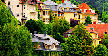 Houses along the Neckar River in Heidelberg, Germany. Photo via Flickr:Tobias von der Haar