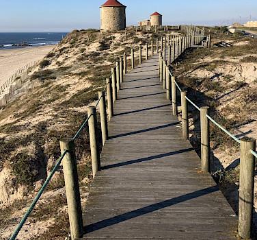 Boardwalk to beach in Esposende in northern Portugal. Flickr:Sergei Gussev