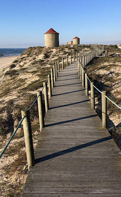 Boardwalk to beach in Esposende in northern Portugal. Flickr:Sergei Gussev