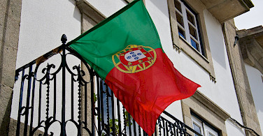 Flag of Portugal flying proudly over Valença, Portugal. Flickr:Mario Sanchez Prada