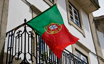 Flag of Portugal flying proudly over Valença, Portugal. Flickr:Mario Sanchez Prada